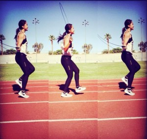 women jumping rope on track
