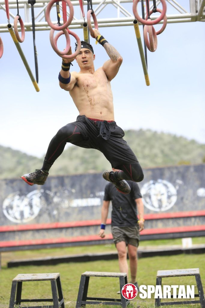 Adam crossing the multi-rings obstacle in the Spartan race
