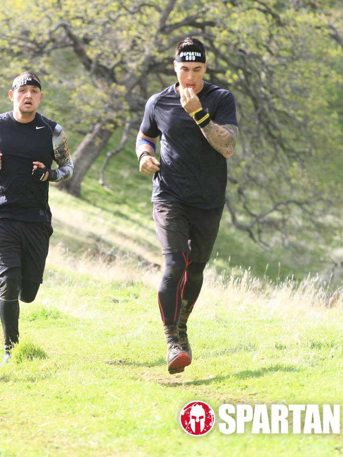 Adam (center) running in the San Jose Spartan race